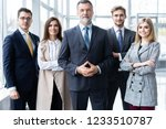happy business team with arms... | Shutterstock . vector #1233510787
