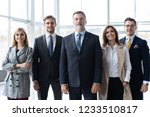 happy business team with arms... | Shutterstock . vector #1233510817