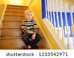 cute little boy in striped... | Shutterstock . vector #1233542971