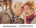 beautiful senior couple kissing ... | Shutterstock . vector #1233571351