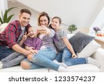 family lifestyle portrait of a... | Shutterstock . vector #1233574237