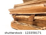 Very old books isolated on white. Closeup focus - stock photo