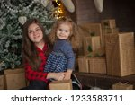 beautiful sisters on christmas... | Shutterstock . vector #1233583711