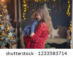 beautiful sisters on christmas... | Shutterstock . vector #1233583714