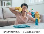 asian woman using sprayer and... | Shutterstock . vector #1233618484