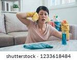 asian woman using sprayer and... | Shutterstock . vector #1233618484
