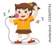 a girl singing with microphone... | Shutterstock .eps vector #1233695761