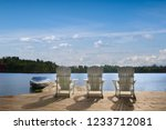 three chairs sitting on a... | Shutterstock . vector #1233712081