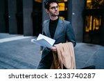 successful handsome... | Shutterstock . vector #1233740287