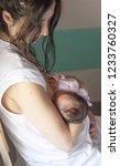 mother breastfeeding her... | Shutterstock . vector #1233760327