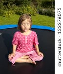 little girl  meditation on... | Shutterstock . vector #123376075