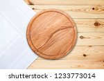table cloth and pizza board on... | Shutterstock . vector #1233773014