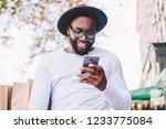 smiling dark skinned african... | Shutterstock . vector #1233775084