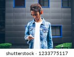 stylish hindu hipster listening ... | Shutterstock . vector #1233775117