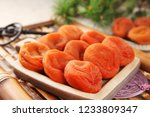dried persimmon on a plate | Shutterstock . vector #1233809347