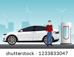 man charges an electric car at... | Shutterstock .eps vector #1233833047