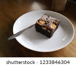 delicious chocolate brownie... | Shutterstock . vector #1233846304