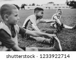 Diverse Kids Stretching On The...