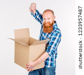 bearded man with a gift on... | Shutterstock . vector #1233957487
