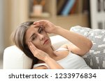 woman suffering from headache... | Shutterstock . vector #1233976834