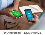 closeup hands holding mobile... | Shutterstock . vector #1233990421