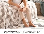 young woman suffering from leg... | Shutterstock . vector #1234028164