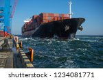 container ship in port at... | Shutterstock . vector #1234081771