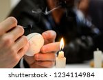 closeup of hands holding candle ... | Shutterstock . vector #1234114984