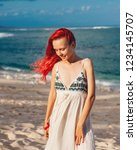 woman with red hair on vacation ...   Shutterstock . vector #1234145707