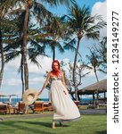 woman with red hair on vacation ...   Shutterstock . vector #1234149277