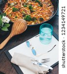 paella pan served in cafe   Shutterstock . vector #1234149721