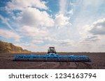 farmer in tractor preparing... | Shutterstock . vector #1234163794