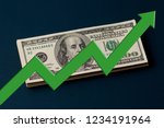 green arrow is up background the dollar - stock photo