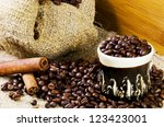 cup of coffee and  cinamon on ...   Shutterstock . vector #123423001