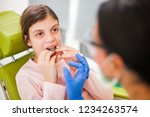 dentist is teaching little girl ... | Shutterstock . vector #1234263574