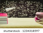 paper planes and wooden table... | Shutterstock . vector #1234318597