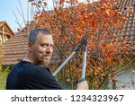 man working in garden with a... | Shutterstock . vector #1234323967