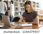female asian student studying...   Shutterstock . vector #1234379557