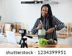 happy african american woman... | Shutterstock . vector #1234399951