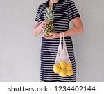 young women holding pineapple... | Shutterstock . vector #1234402144