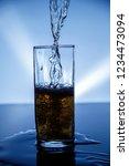 natural drink of dark yellow... | Shutterstock . vector #1234473094