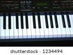 Electric piano keys. - stock photo