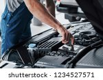 mechanic hands checking up of... | Shutterstock . vector #1234527571