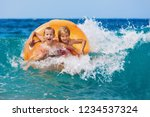 happy kids have fun in sea surf ... | Shutterstock . vector #1234537324
