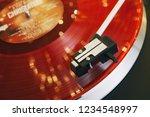 red vinyl record closeup on a... | Shutterstock . vector #1234548997