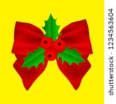 red christmas bow with holly on ... | Shutterstock . vector #1234563604