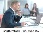 businessman looking at laptop... | Shutterstock . vector #1234566157
