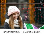 laughing blonde woman wearing... | Shutterstock . vector #1234581184