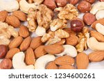 healthy different nuts and... | Shutterstock . vector #1234600261