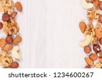 frame of healthy different nuts ... | Shutterstock . vector #1234600267